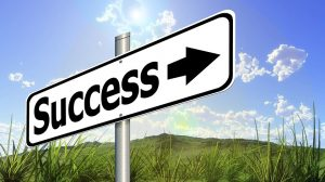 Street sign that says Success