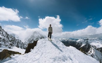 Person standing on mountain top