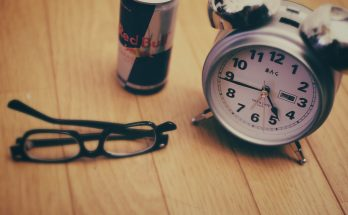 Alarm clock, Red Bull, glasses