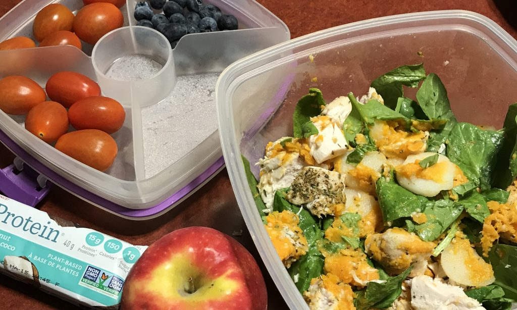 Salad, apple, tomatoes, and blueberries