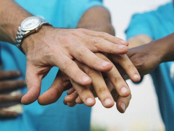 Adult hands touching each other